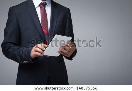 Businessman work on modern digital tablet computer - stock photo