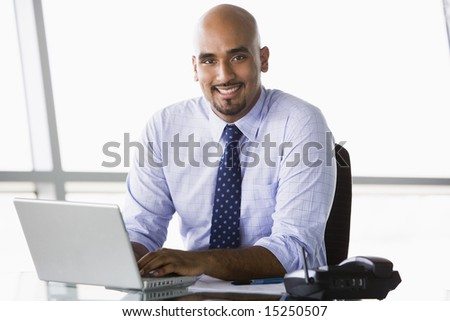 Businessman working at desk in office - stock photo