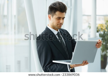 Businessman Working at his Laptop.
