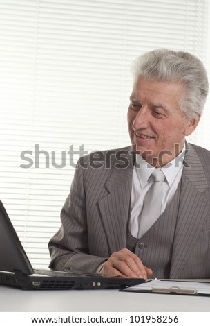 Businessman working at the computer on a white