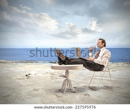 Businessman working at the seaside