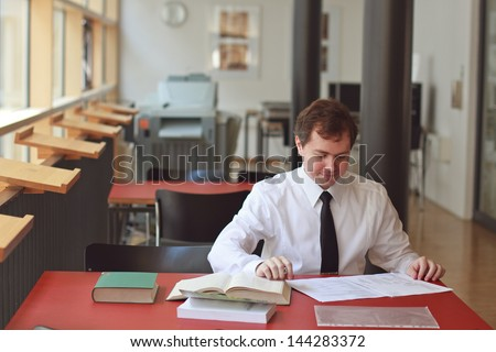 Businessman working at the table