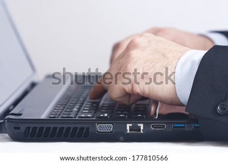 Businessman working in office with computer