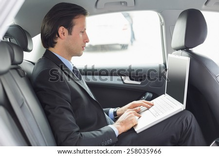 Businessman working in the car
