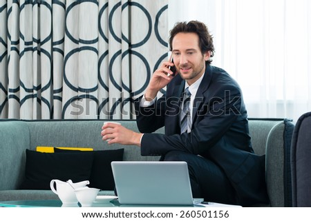 Businessman working in the hotel, he using wifi to read emails with the computer - stock photo