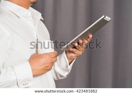 Businessman working on a digital tablet - stock photo