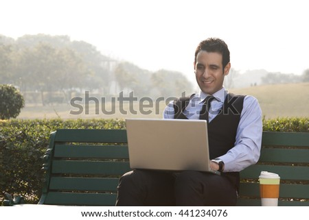Businessman working on a laptop INDIA DELHI