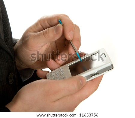 Businessman working on a pda organizer isolated over white background - stock photo