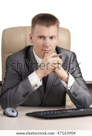 Businessman working on computer in her office