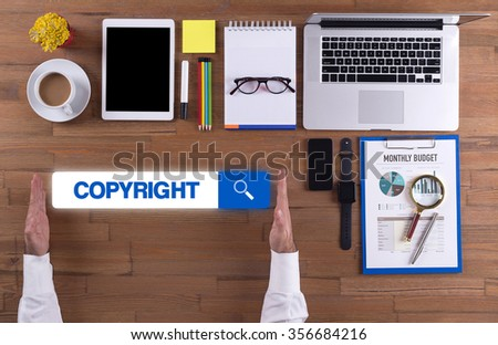 Businessman working on desk - COPYRIGHT concept - stock photo