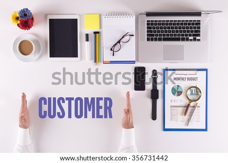 Businessman working on desk - hands showing CUSTOMER concept - stock photo