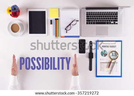 Businessman working on desk - hands showing POSSIBILITY concept - stock photo
