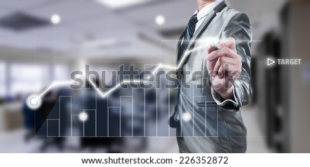 Businessman working on digital chart, business strategy concept - stock photo