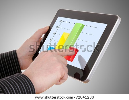 businessman working on financial graph on tablet - stock photo