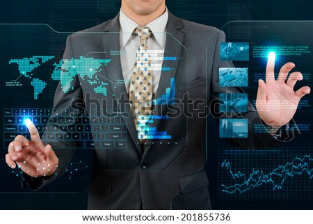 businessman working on futuristic transparent display - stock photo