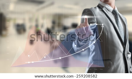 Businessman working on high growth graph, business concept - stock photo