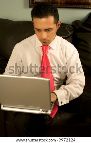 Businessman Working on his Laptop Sitting on the Couch