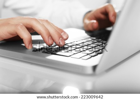 businessman working on laptop, close up - stock photo