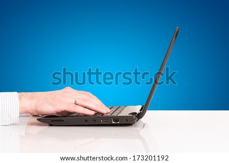 Businessman working on laptop, hands typing - stock photo