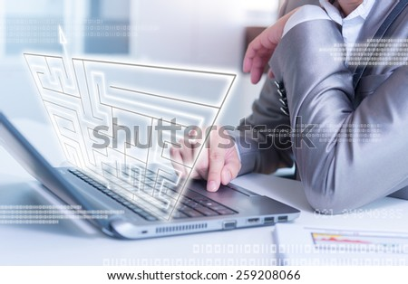 businessman working on laptop maze solving, business strategy concept - stock photo