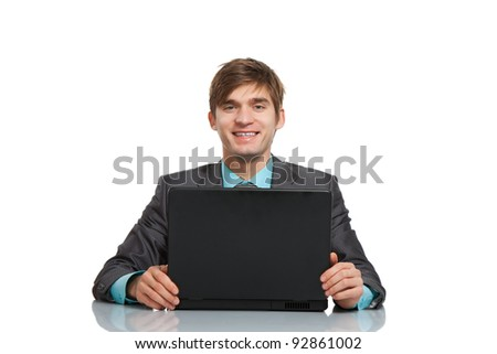 businessman working on laptop, using computer, handsome young business man happy smile sitting at the desk, wear elegant suit and tie isolated over white background - stock photo