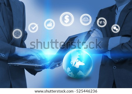 Businessman working on laptop with business icons.