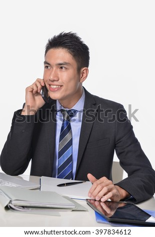 businessman working on laptop, with mobile phone - stock photo
