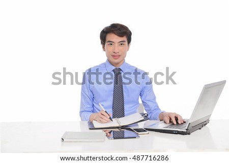 businessman working on laptop, young business man happy smile sitting at the desk,