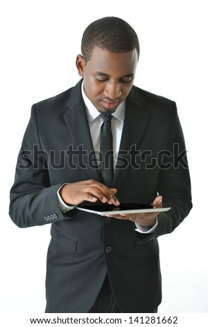 Businessman working on tablet - stock photo