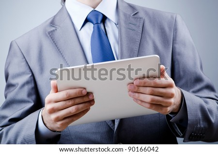 Businessman working on tablet computer - stock photo
