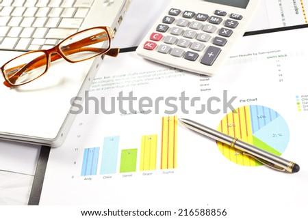 Businessman working on the calculator and his laptop to analyze the investment charts, Accounting and financial concept - stock photo