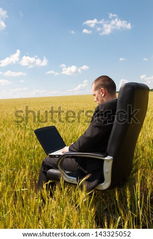 Businessman working with a laptop outdoor - stock photo
