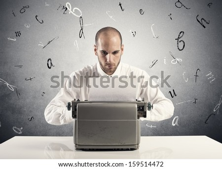 Businessman working with an old typewriter