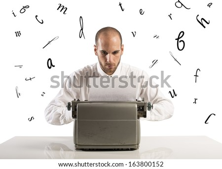 Businessman working with an old typewriter - stock photo