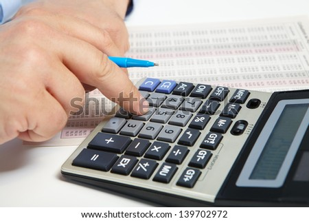 Businessman working with  calculator in the office