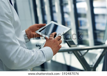 Businessman working with  digital tablet - stock photo