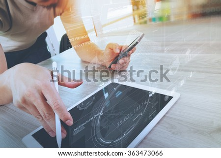 businessman working with digital tablet computer and smart phone with digital business strategy layer effect on wooden desk as concept - stock photo