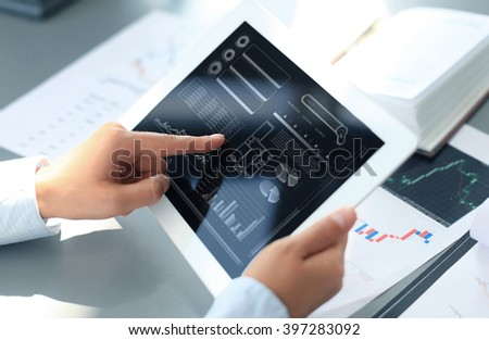 businessman working with digital tablet computer on wooden desk as concept
