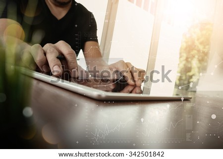 businessman working with digital tablet computer with digital business strategy layer effect on wooden desk with green plant foreground as concept - stock photo
