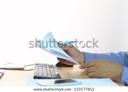 Businessman working with document - stock photo