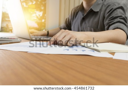 businessman working with document and computer notebook laptop on office desk