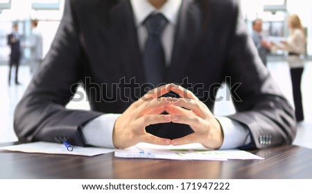 Businessman working with documents in the office - stock photo