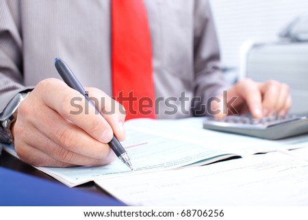 Businessman working with documents in the office