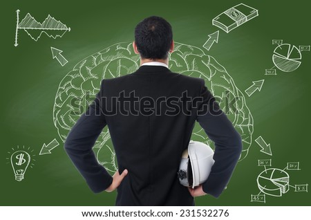 Businessman working with finance graph for trade stock market on the blackboard. - stock photo