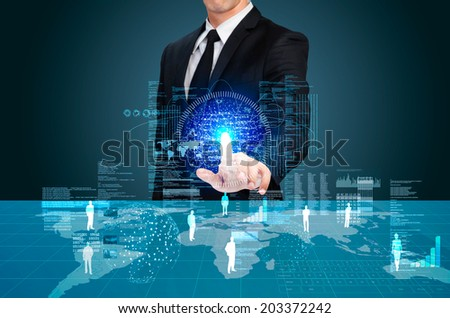 businessman working with futuristic Illuminate touch screen table - stock photo