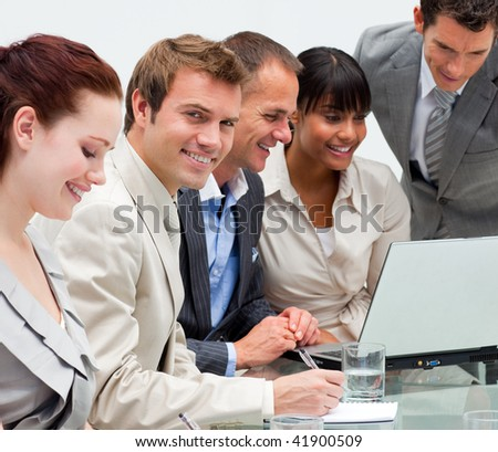 Businessman working with his team with a laptop