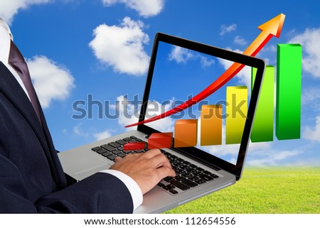 businessman working with laptop and Growth Colorful Bar Diagram
