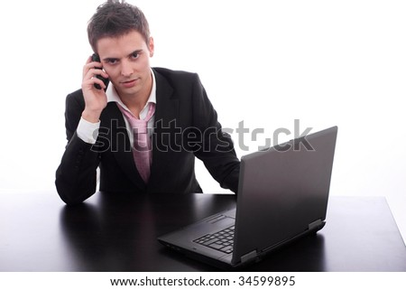 Businessman working with laptop, isolated over white