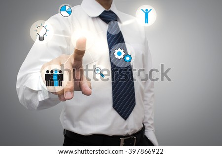 Businessman working with modern virtual technology, hand touching pointing to businessman icon in the middle that linked with each other as network - HR,HRM,HRD, teamwork & leadership concept - stock photo