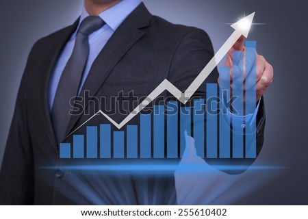 Businessman Working with Virtual Screen - stock photo